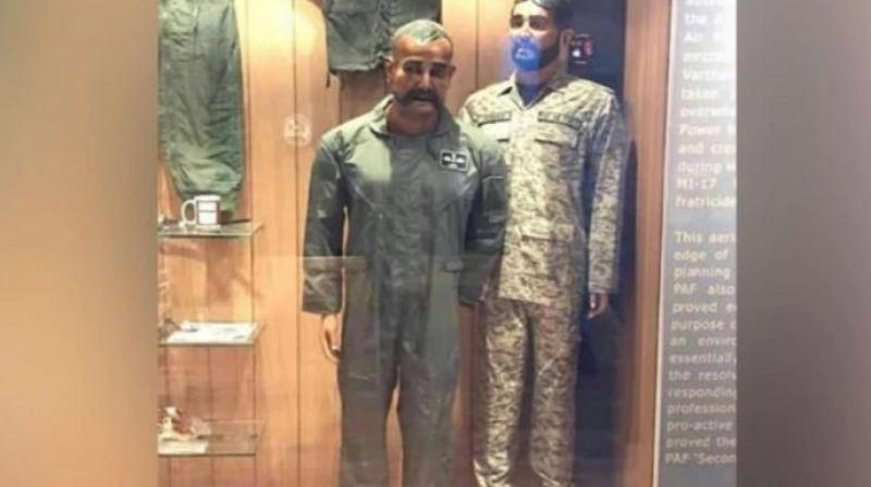 The photograph shared by Lodhi on the microblogging site also captured a mug placed behind on the left-hand side of the Abhinandan's mannequin which was flanked by a Pakistani soldier. (Photo: Twitter)
