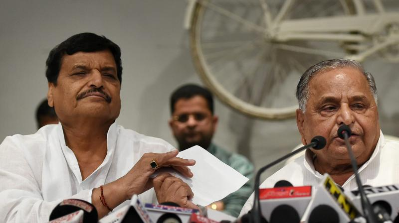 Shivpal Yadav and Mulayam Singh Yadav. (Photo: PTI)