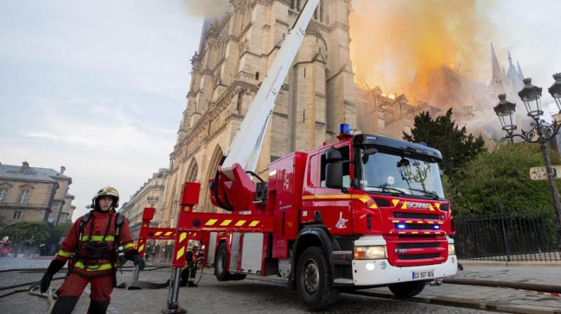 Paris Fire Brigade shows fire fighters working at the burning Notre Dame cathedral. (Photo: AP)