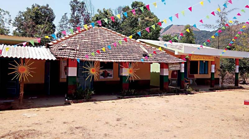 One of the ethnic polling booths set up in the Shivamogga constituency to encourage Hakki Pakki tribal people to vote in Tuesday's election – DC