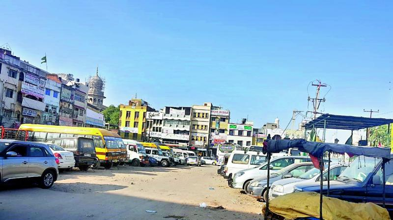 Private vehicles are parked in the area that was once the Charminar bus stand. The bus stand was removed after traffic was barred near the monument.