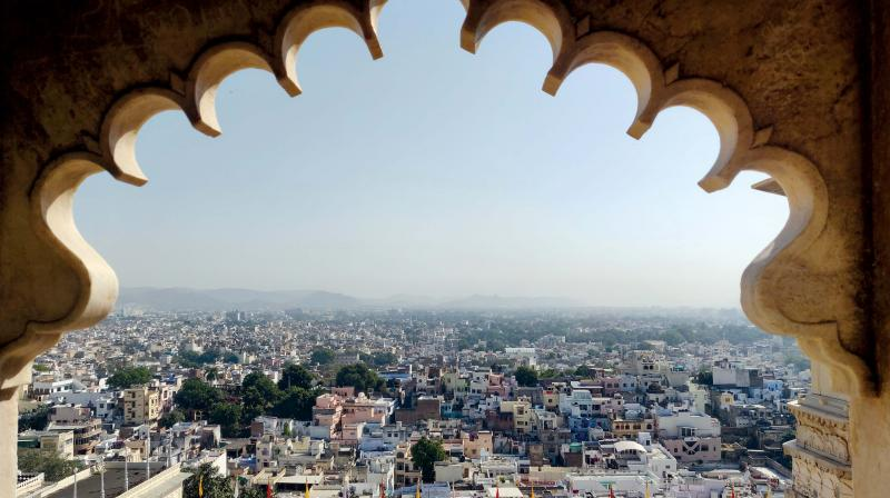 The city of Udaipur framed from the city palace