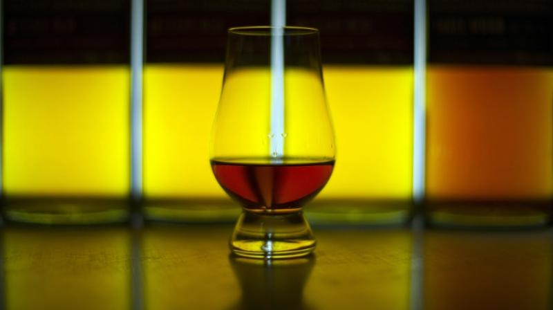 Whisky is poured over a chequerboard pattern of tiny pieces of gold and aluminium and researchers then measure how they absorb light while submerged. (Photo: AFP)