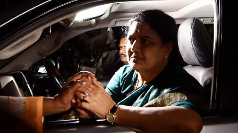 AIADMK General Secretary V K Sasikala consoled by a lady on the way from Koovathur Resort to Poes Garden at Koovathur, outskrits of Chennai on Tuesday. (Photo: PTI)