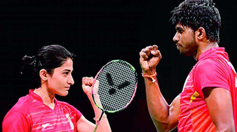 Ashwini Ponnappa (left) and Rankireddy Satwiksairaj celebrate a point during a match in this file photo.