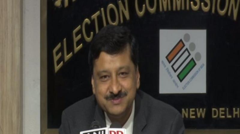 Deputy Election Commissioner Sandeep Saxena announced the brief report. (Photo: ANI)