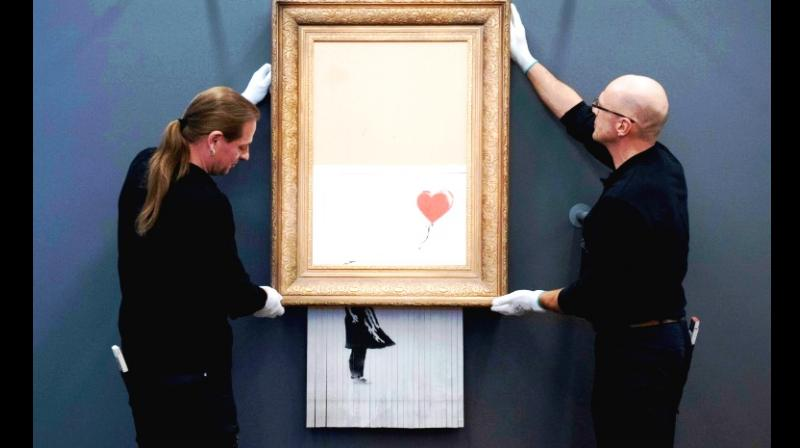 The artwork 'Love is in the Bin' by Banksy has been put up at the Frieder Burda Museum in Baden-Baden, Germany. (Photo: AFP)
