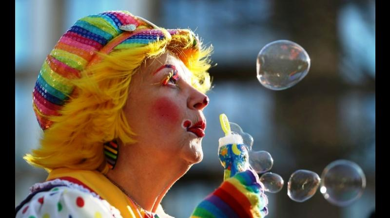 Canadian Annie Bannanie blew bubbles before an annual service in east London to honour Grimaldi. (Photo: AFP)