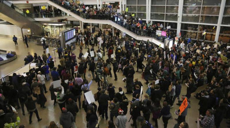 More than 1,000 people gather at Seattle-Tacoma International Airport, to protest President Donald Trump's order that restricts immigration to the U.S. (Photo: AP)