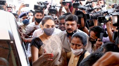 Kannada actress Ragini Dwivedi being escorted to an interrogation in Bengaluru. All the film personalities being investigated for drug abuse in Bollywood are women. (PTI)