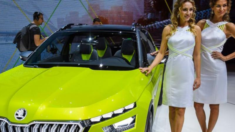 Leggy and heavily made-up models still adorn the stands at the Geneva show, though there seems to be a bit show than previous years. (Photo: AP)