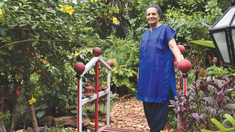 The lovely Priya taking her daily walk around her garden