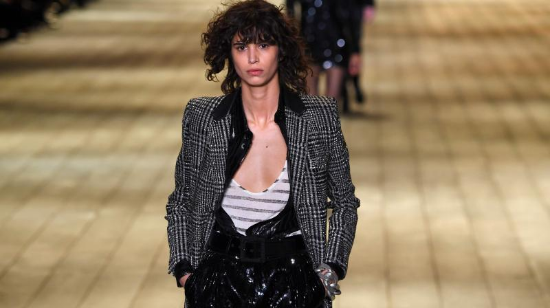 21f6bd77a8fd A model presents a creation for Saint Laurent during the 2018/2019 fall/ winter