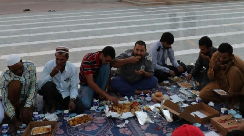 During Ramadan, immigrants in the Gulf state reconnect with traditions from their homeland, especially the rituals of breaking the fast and taking lots of traditional desserts and juices. (Photo: AFP)