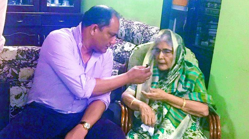 Former Indian cricket captain Mohammad Azharuddin offers a piece of cake to his 79-year-old mother Yousuf Sultana after being elected president of the Hyderabad Cricket Association on Friday night.