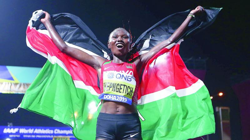 Kenya's Ruth Chepngetich celebrates after winning the Women's Marathon in Doha. (Photo: AFP)