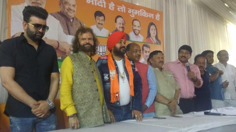 BJP's candidate from northwest Delhi constituency Hans Raj Hans, Union minister and Chandni Chowk candidate Harsh Vardhan and other party leaders were also present. (Photo: ANI twitter)