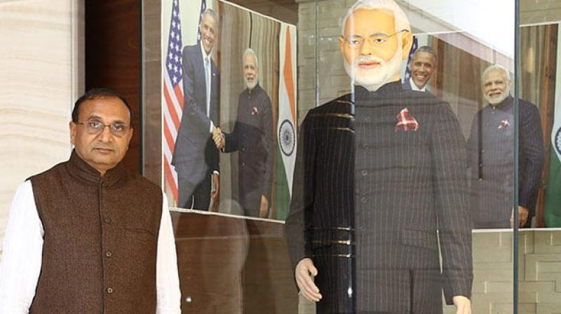 Laljibhai Patel, chairman of Dharmanandan Diamonds Pvt Ltd, had hit the headlines in 2015 when he bought Modi's much-famed pinstripe suit for Rs. 4.31 crore in a public auction.  (Photo: Guinnessworlrecords.com)