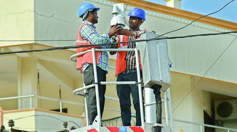 File picture of workers fixing CCTV cameras.