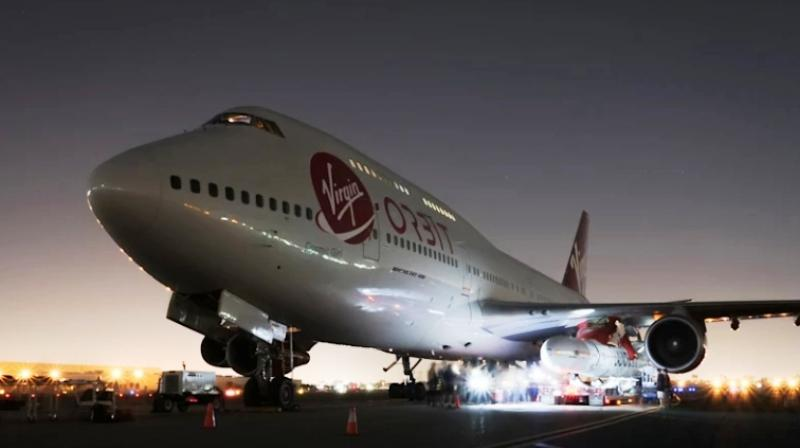 Virgin Atlantic has taken one of their commuter Boeing 747-400 aircraft, called the Cosmic Girl, and modified it heavily to make the rocket launch possible. (Photo: Virgin Orbit)