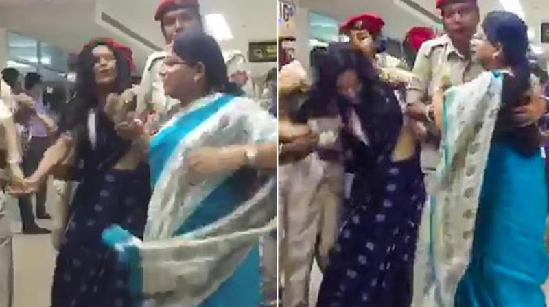 Footage from the Silchar airport shows women lawmakers in the Trinamool delegation running as they were chased and restrained by policewomen. (Photo: PTI)