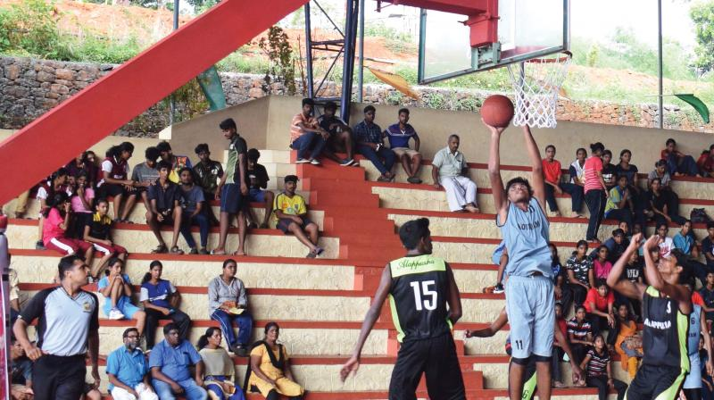Sajeesh scores for Kottayam against Alappuzha in a boys' group match in the state junior basketball  championship at Thodupuzha.
