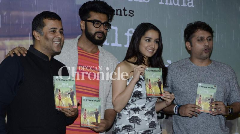 Arjun Kapoor and Shraddha Kapoor, who are starring in the film adaptation of Chetan Bhagat's popular book 'Half Girlfriend', re-launched the book with a new cover starring themselves at an event in Mumbai on Monday. (Photo: Viral Bhayani)