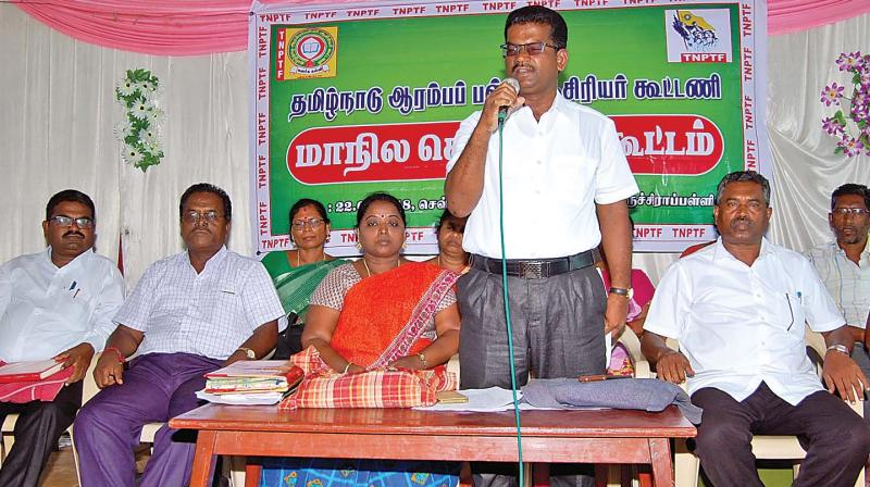 S.Mayil, state general secretary of the  Tamil Nadu Primary School Teachers Federation, addresses their state executive at Tiruchy on Tuesday.(Photo: DC)