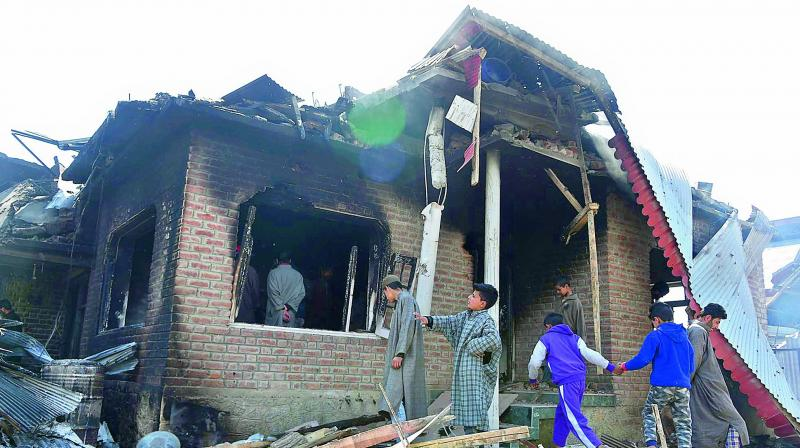 The house was razed to ground during a gunfight between militants and security forces in Hajin area of Bandipora District in Kashmir. (H.U. Naqash)