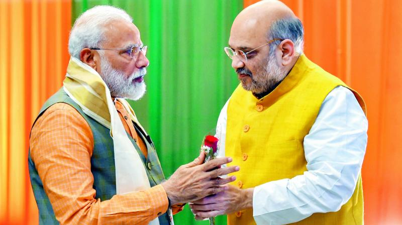 Prime Minister Narendra Modi and BJP president Amit Shah during the BJP Central Election Committee meeting at the BJP headquarters in New Delhi. (PTI)