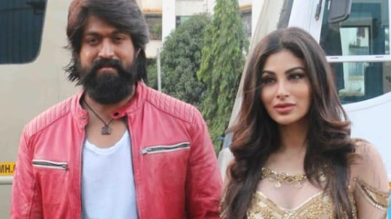 Mouni Roy and actor Yash on-set.