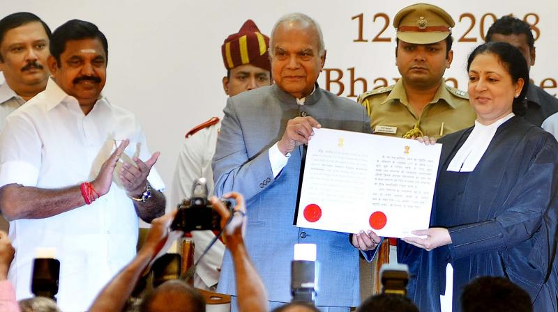 Governor Banwarilal Purohit and the new Chief Justice of Madras high court Vijaya Kamlesh Tahilramani with the latter's Warrant of Appointment during the swearing-in ceremony in Raj Bhavan on Sunday. Also seen is Chief Minister Edappadi K. Palaniswami.  (Photo:DC)