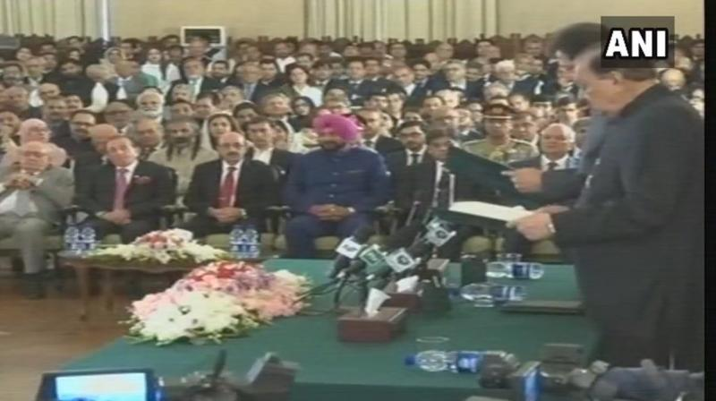 Sidhu arrived in Lahore on Friday via the Wagah border. He travelled from Lahore to Islamabad to attend the ceremony.(Photo: ANI/Twitter)