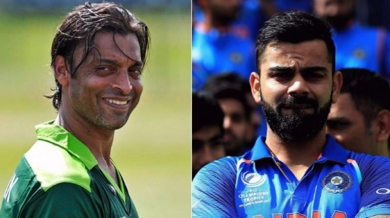 Shoaib Akhtar, who witnessed many heated conversations with players from the neighbouring country during his playing days, was impressed what the Indian talisman did after the match. (Photo: AFP/BCCI)