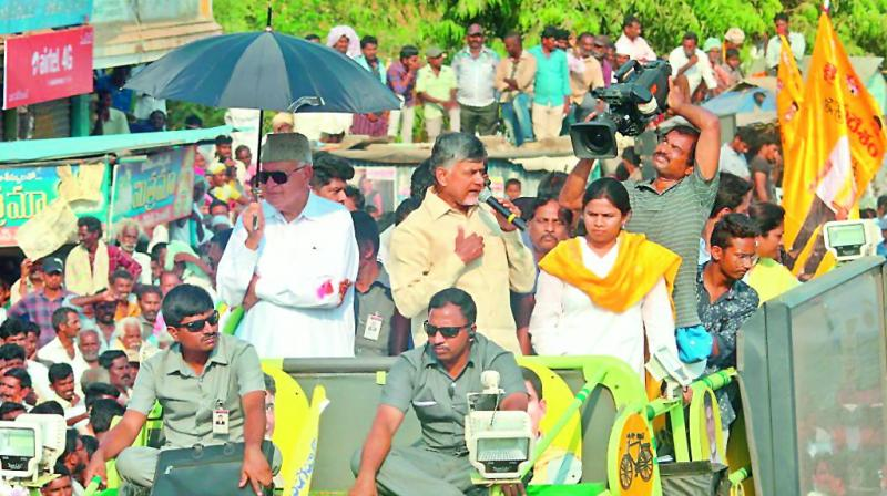 National Conference president Farooq Abdullah (left) with Telugu Desam president and Andhra Pradesh Chief Minister N. Chandrababu Naidu (left) during an election campaign roadshow in Kadapa on Tuesday. (Photo: PTI)