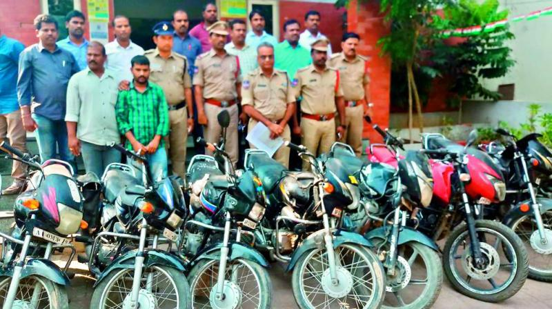 Veerabadrappa (in green shirt) with the police. — DC