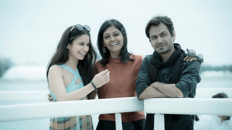 Nawazzuddin Siddiqui and Rashika Duggal snapped with film's director Nandita Das at Cannes.