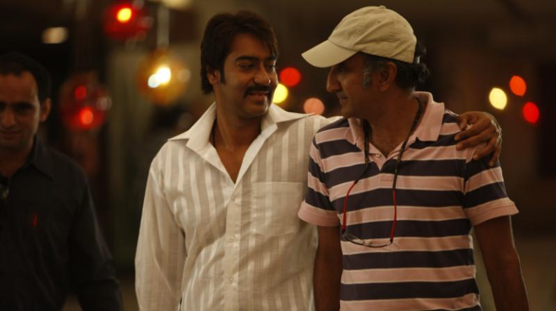 Milan Luthria snapped with Ajay Devgn