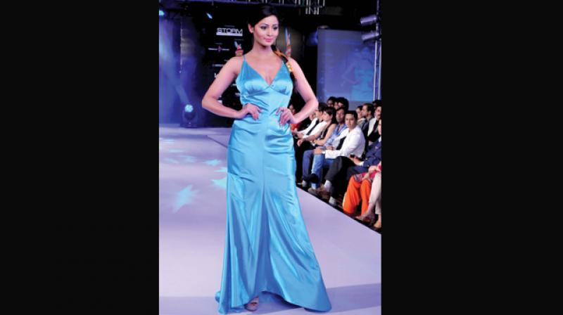 A city model walks the ramp sashaying the latest trend of slip dresses...