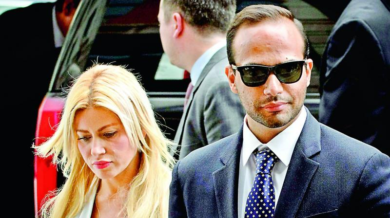 Foreign policy adviser to US President Donald Trump's election campaign, George Papadopoulos and his wife Simona Mangiante arrive at US district court for his sentencing in Washington DC on Friday. (Photo: AFP)