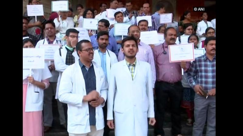 Following an allegation of a doctor being physically assaulted by patient's relatives, junior doctors of Gandhi Hospital here continued their protest on Thursday over the safety and security of the doctors. (Photo: ANI)