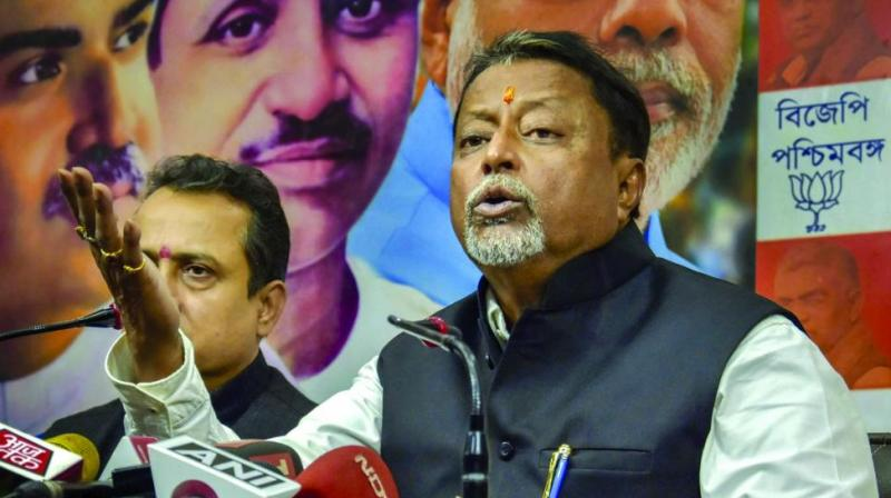 BJP leader Mukul Roy addresses a media conference at his office in Kolkata. (Photo: PTI)