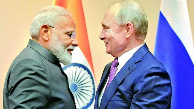 Prime Minister Narendra Modi and Vladimir Putin.