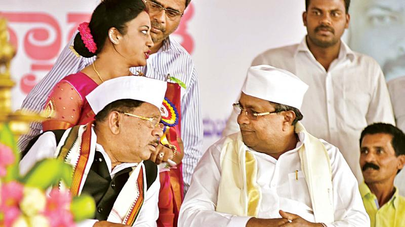 Chief Minister Siddaramaiah and KPCC president Dr G. Parameshwar at an event in Kodagu on Tuesday