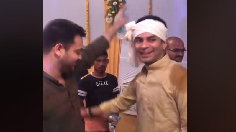 Tejashwi Yadav has shared a video of him dancing with brother and groom Tej Pratap Yadav. (Photo: ANI | Screengrab)