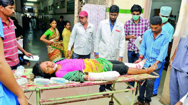 Ragpicker, R. Nirmala, 25, lost her fingers when she tried to break open a container which exploded at Jillelaguda in Meerpet on Friday. She has been admitted to Osmania General Hospital. (Photo: P. Surendra)