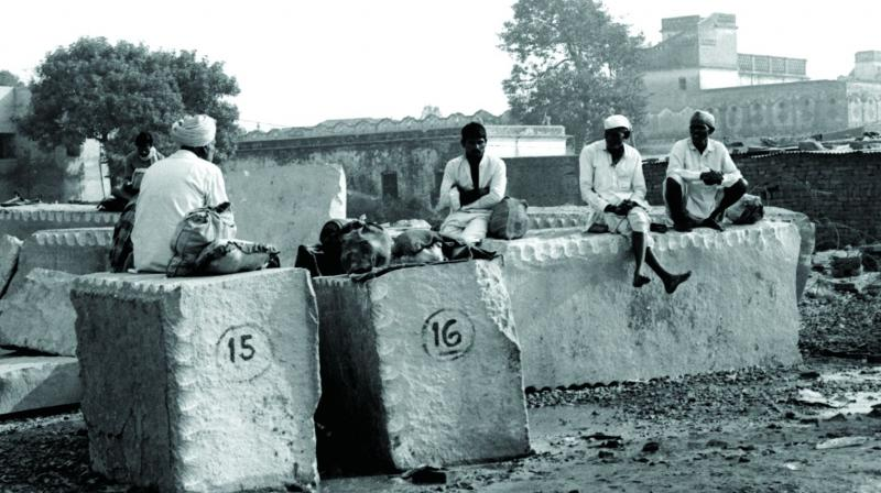 The wait is getting over Kar Sevaks resting on partially carved stone slabs to be used as pillars of the proposed Ram temple near Babri Masjid. (Photo: Archive of Sondeep Shankar)