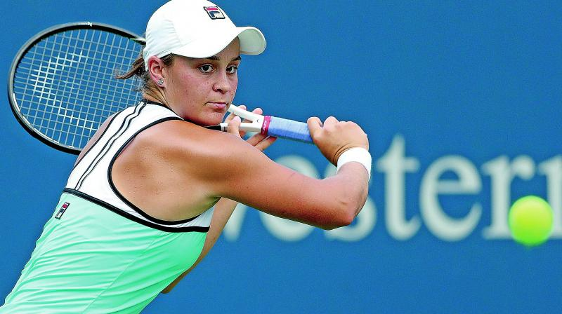 Top seed Ashleigh Barty in action against Maria Sharapova. (Photo: AP)