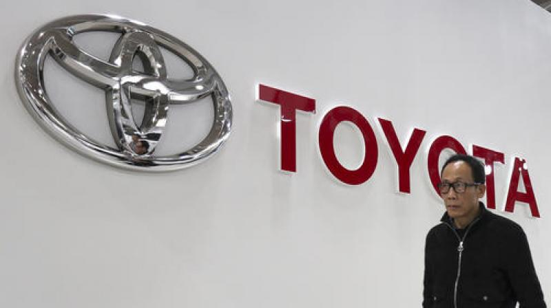 Toyota will place one of its executives on Grab's board, and a second Toyota team member will serve as an executive officer at the company. (Photo: AP)