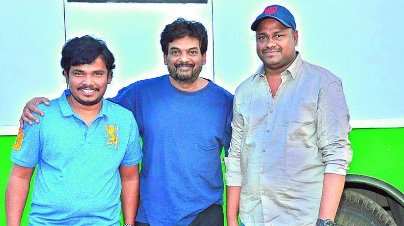Sampoornesh Babu and Sai Rajesh, producer of Kobbari Matta, met Puri Jagannadh for the unveiling of a song trailer recently